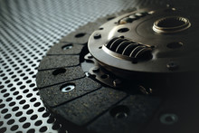 Car Clutch On A Metal Surface