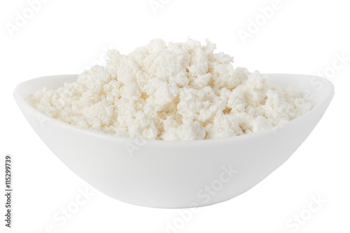 Staande foto Zuivelproducten cottage cheese in a bowl isolated on a white background - with clipping path