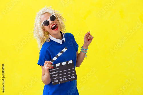 Woman holdien movie directors sceene card