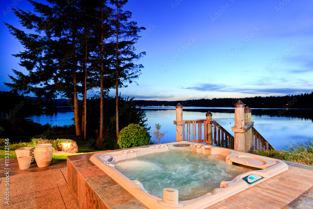 Fototapeta Awesome water view with hot tub at dusk in summer evening.