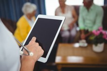 Close-up Of A Nurse Holding A Digital Tablet