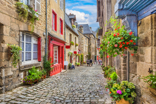 plakat Idyllic scene of traditional houses in narrow alley in an old town in Europe