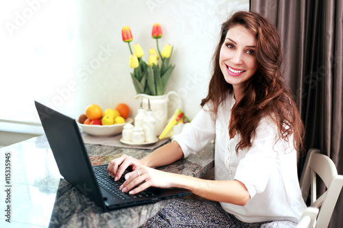 woman working at home on laptop Poster