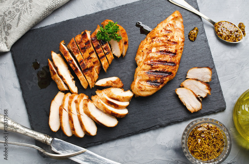 Fotobehang Kip Grilled chicken fillets in a spicy marinade