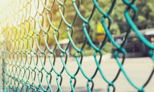 Fotografia Wire fence with futsal field on background