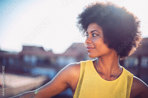 Stampe  Beautiful African girl with curly hair on the rooftop