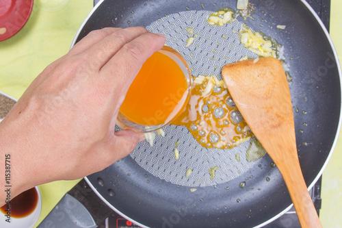 Photo  Cooking orange sauce for fish steak
