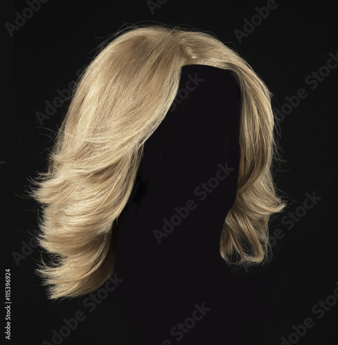 female blonde wig on a black background Fototapete