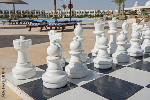 Giant chess board game in tropical resort Canvas Print