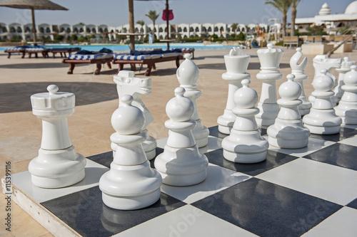 Wallpaper Mural Giant chess board game in tropical resort