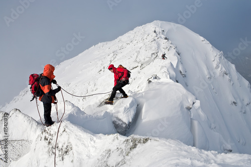 Photo Stands Mountaineering Climbing in mountains. Team work.