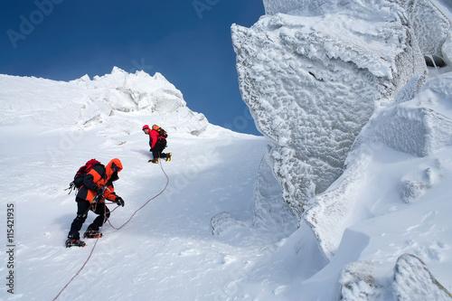 Spoed Fotobehang Alpinisme Climbing in mountains. Team work.