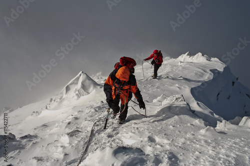 Deurstickers Alpinisme Climbing in mountains. Team work.