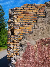 Wall Repaired With Yellow Bricks, Sunny Day