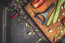 Green  Beans Cooking Preparation With Vegetables Peeler On Dark Wooden Background, Top View, Border