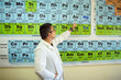 Teacher at Class With Periodic Table of the Elements