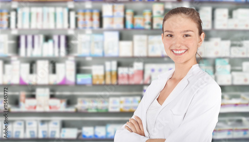 Tuinposter Apotheek Young pharmacist in pharmacy