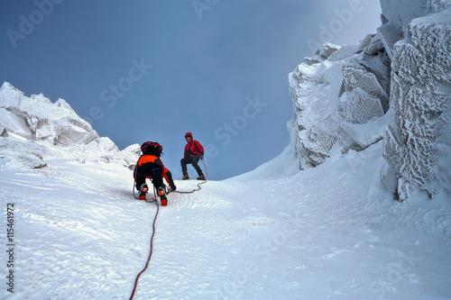 Poster de jardin Alpinisme Climbing in mountains. Team work.