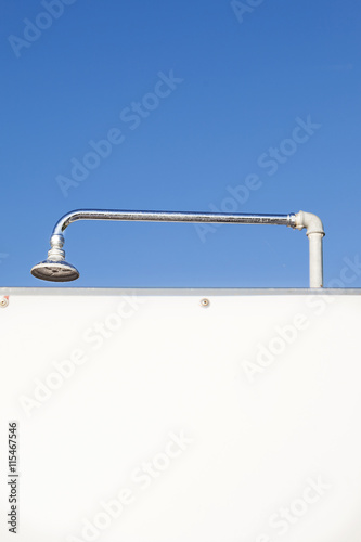 outdoor showers on a campsite in summer