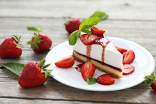 Strawberry Cheesecake On Plate On Grey Wooden Table