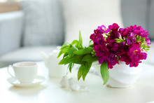 Vase With Flowers On The Table In The Room