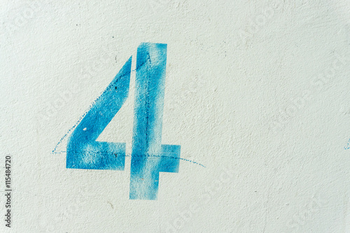 Photo  the number 4 on the dirty white wall