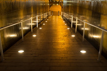 Lighted Walkway With A Fountain On Each Side