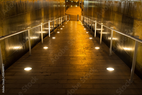 Fotografie, Obraz  lighted walkway with a fountain on each side