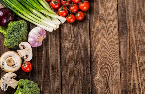Foto op Plexiglas Fitness Vegetables on wood. Bio Healthy food, herbs and spices. Organic
