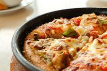 Closeup Pizza In Hot Pan