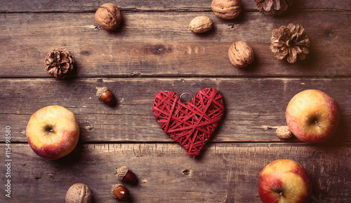 apples, heart shaped toy, fir-cones and nuts Tablou Canvas