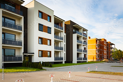Fototapeta New multi-family block with balconies and bright facade decorated with wood paneling. obraz