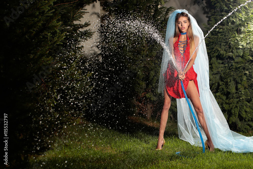 Stampa su Tela woman in veil with hose and water