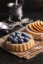 Tartlets Filled With Cream And Blueberries And Peaches For Tea Time
