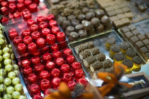 fototapeta na lodówkę Assortment of chocolates with ganache and pralines fillings
