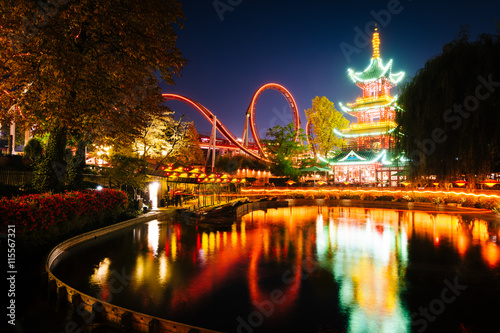 Amusement Park The Japanese Tower and rides at night, reflecting in a lake at T