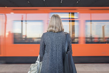 Rear View Of Woman Standing On Helsinki Metro Station