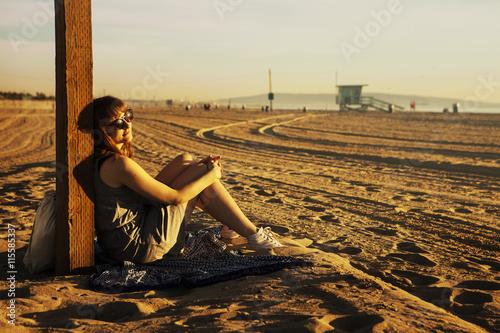 USA, California, Los Angeles, Santa Monica, Mid adult woman sitting on beach