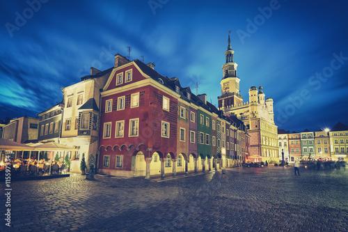 Obrazy na płótnie Canvas Retro stylized Old Market Square in Poznan at night, long exposure effect, Poland.