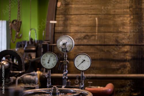 Fototapeta Vintage mining winch empowered by steam engine.