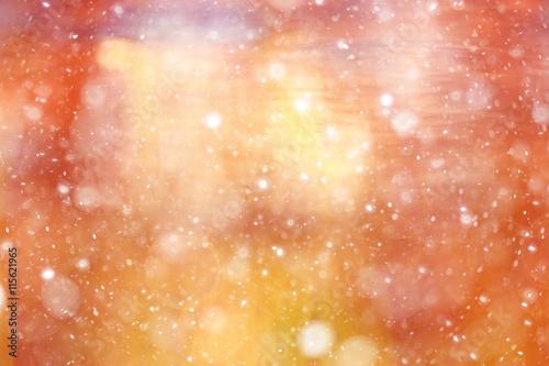 orange bokeh blurred background snowflakes glare
