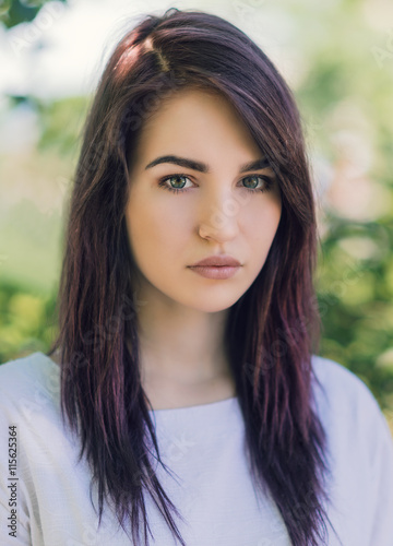 Fototapety, obrazy: Outdoors portrait of beautiful young woman with dark hair.
