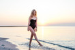 young beautiful woman having fun on beach