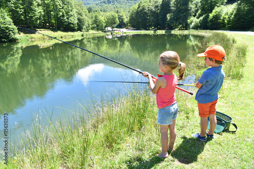 Printed kitchen splashbacks Fishing Kids fishing by mountain lake in summer