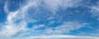 Leinwandbild Motiv Vibrant color panoramic sky with cloud on a sunny day.