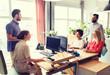 happy creative team talking in office