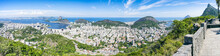 Scenic Panorama Of The Rio De Janeiro, Brazil City Skyline With Sugarloaf Mountain Botafogo And Guanabara Bay Under Bright Blue Brazilian Skies