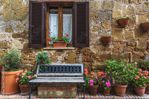 Flower filled streets of the old Italian city in Tuscany. © Jarek Pawlak
