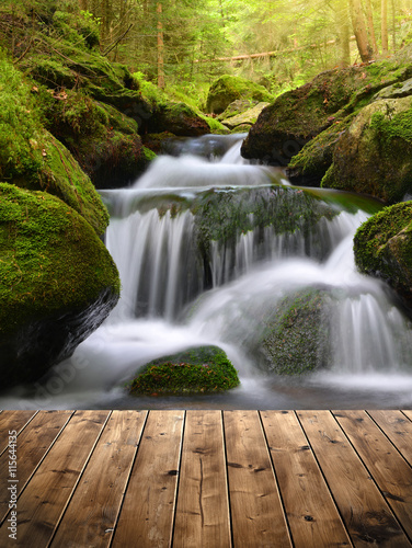 Beautiful waterfall with wooden planks © vencav
