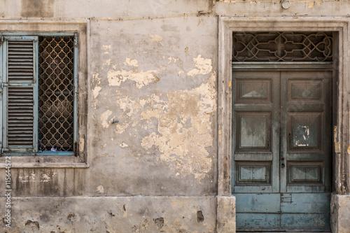 Photo  Grungy old door and window, Valletta, Malta